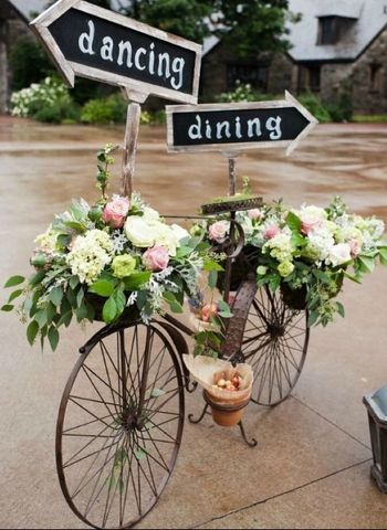 Cycle with floral decor and signboards.