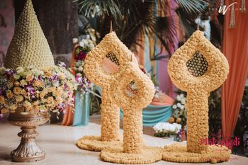 Off-beat floral props to elevate your wedding function decor.