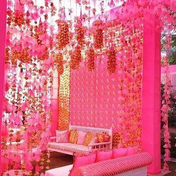 Bright pink mehendi decor idea with suspended decor