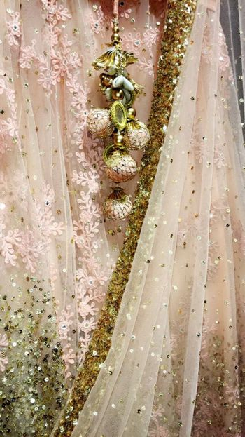 Unique tassel detailing with light pink lehenga