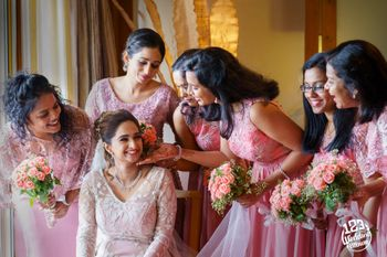 Photo of A Christian bride poses with her bridesmaids.
