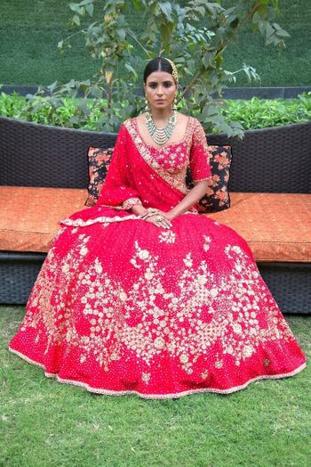 Photo of Light bridal lehenga in red with floral embroidery
