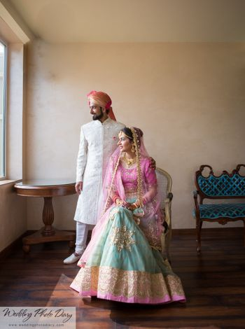 Bride in Pale Blue and Light Pink Bridal Lehenga