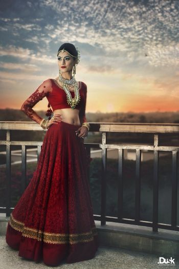 red bridal lehenga with threadwork and pearls in red