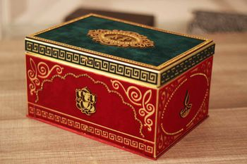 Photo of Emerald green and red boxed