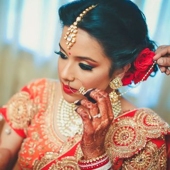 Bridal Makeup with Red Lehenga and Hairstyle with Roses