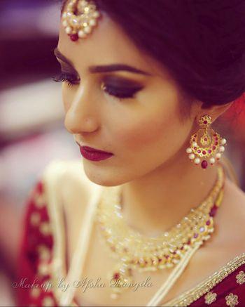 Smokey eye bridal makeup with bold lips