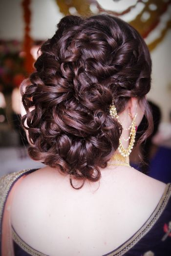 Wavy bun hairstyle for bride sister or mother