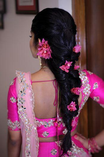 Mehendi braid with big pink flowers
