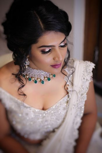 Shimmery eye makeup for engagement with contrasting necklace