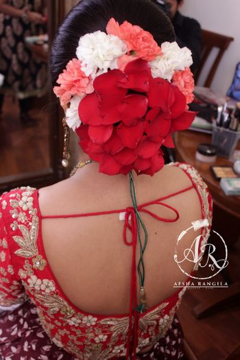 Red bridal bun with petals and flowers
