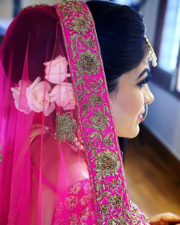 Hairstyle for pink lehenga with white flowers
