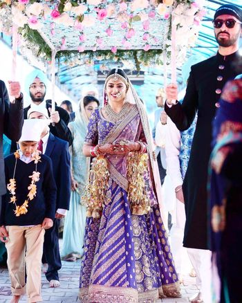 Pretty bridal lehenga in purple with double dupatta drape