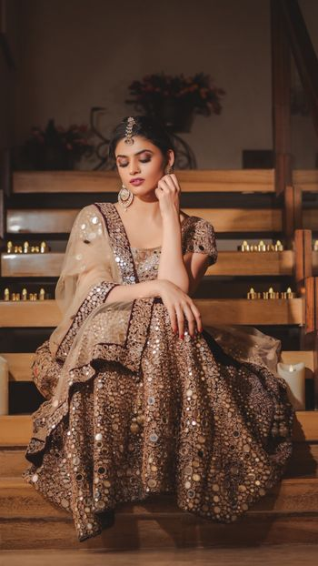 Photo of Brown mirror work lehenga for sangeet