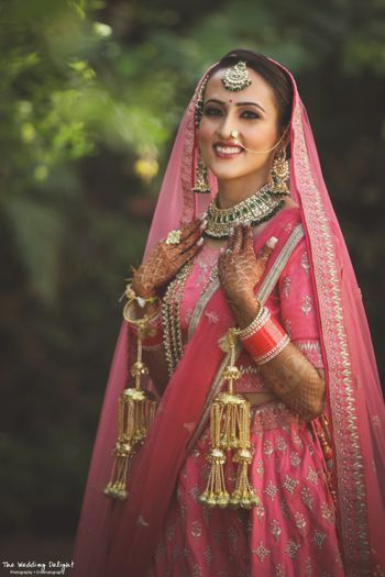 Photo of Sikh bride in bright pink bridal lehenga and kaleere