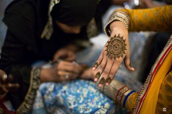 Minimal mandala mehendi design on the back of the hand