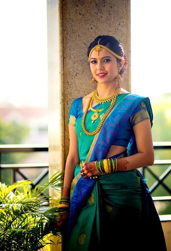 South indian bride in green and blue saree