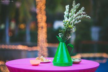 Green teapot with floral arrangement