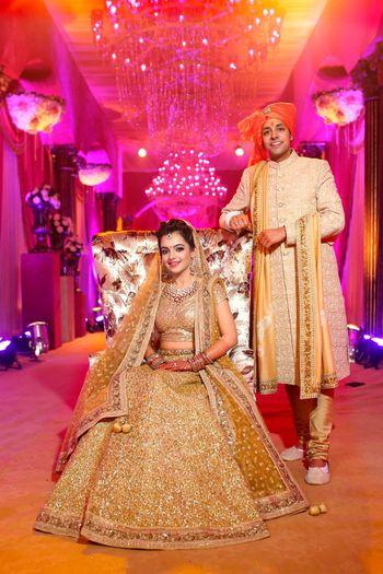 Bride in all gold sequin bridal lehenga