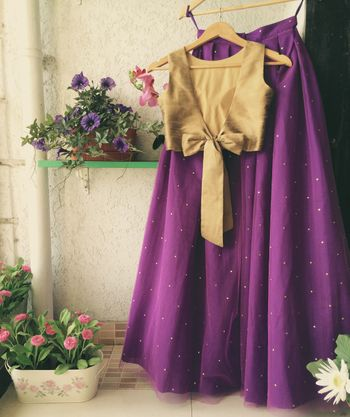 Light purple lehenga with gold blouse with a bow