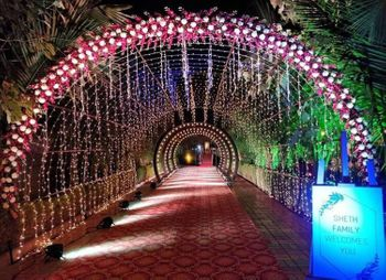 A stunning entrance decor with flowers and fairy lights.