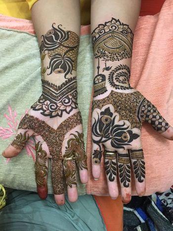 Unique birds and lotus motif bridal mehendi