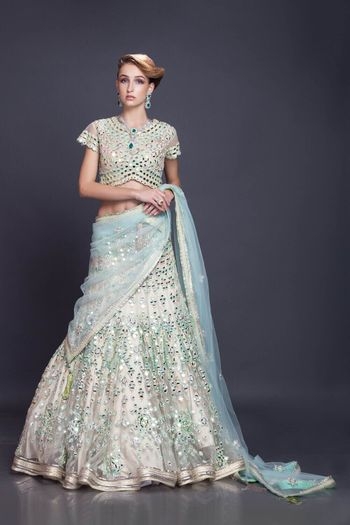 cream and pastel blue lehenga