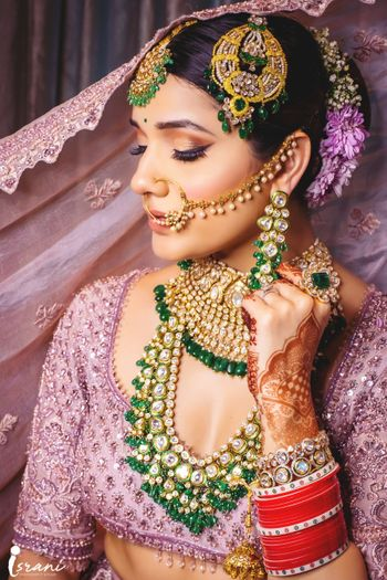 Bride in exquisite Kundan statement jewellery