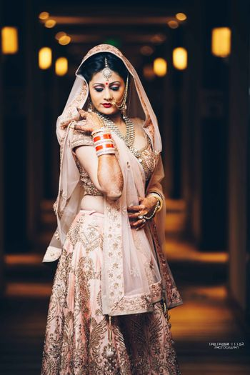 Pink and gold embellished bridal lehenga