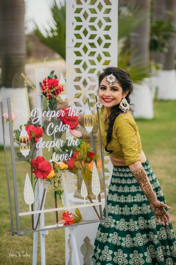 Photo of Mehendi bridal look against cute saying