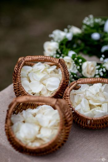 Baskets filled with flower petals for flower shower.