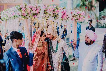 Couple entering under phoolon ka chadar
