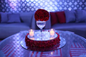 Candle lit red roses table centrepiece decor