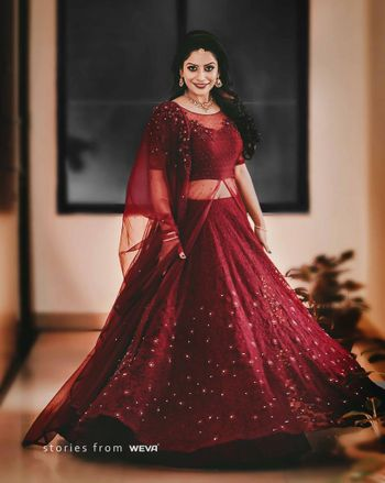 Maroon lehenga for sangeet with cape