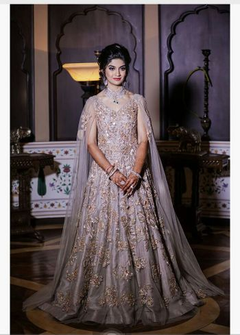 Silver cape gown with floral embroidery