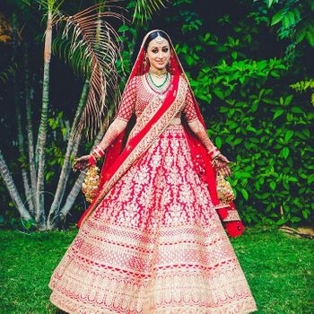 Red and gold bridal lehenga with floral motifs