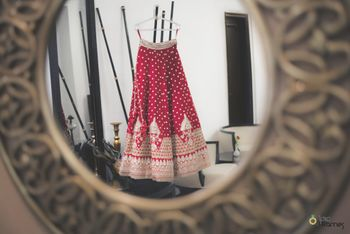 Lehenga on hanger through mirror