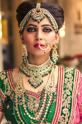 Heavy bridal mathapatti and layered necklaces