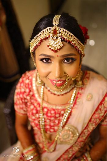 Pretty red and gold mathapatti for wedding day