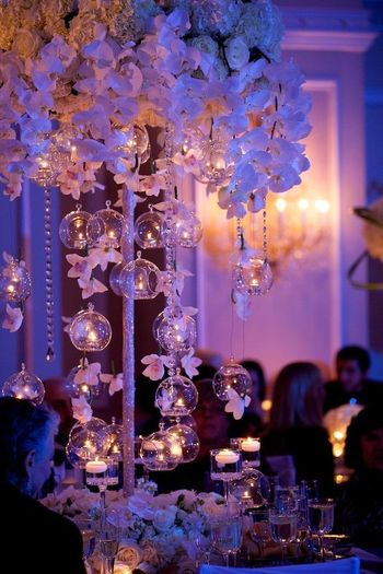 Pretty decor idea with white flowers and hanging balls