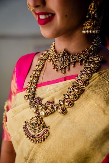 A bride flaunting her gold, temple jewellery