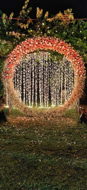Floral wreath photobooth with fairy lights