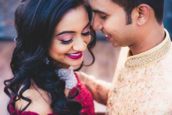 pink eye makeup with deep red lipstick for engagement