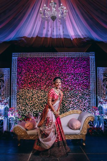 Photo of Happy bride in red and floral sabyasachi lehenga