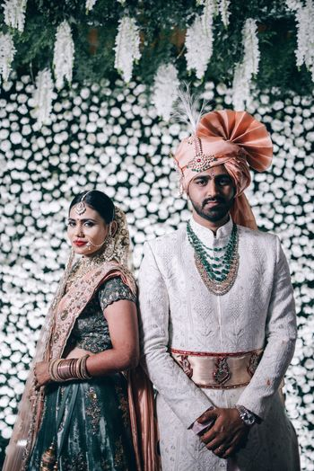 Photo of Modern couple portrait with contrasting bride and groom outfits