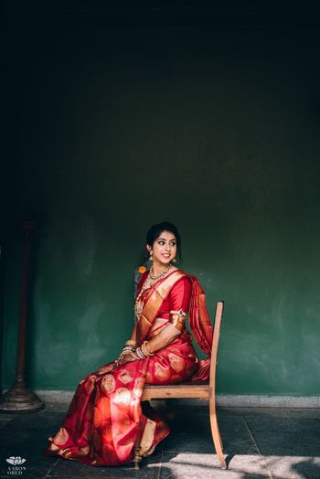 Photo of Red benarasi saree for south indian bride