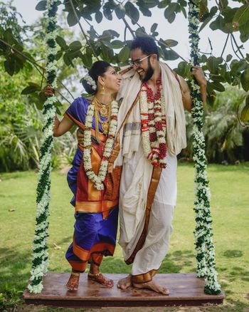 South Indian couple portrait on swing