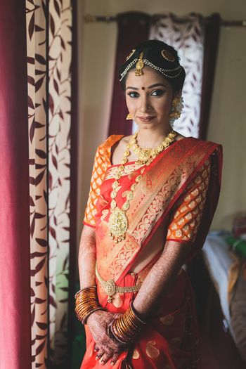 Orange kanjivaram with buti print blouse
