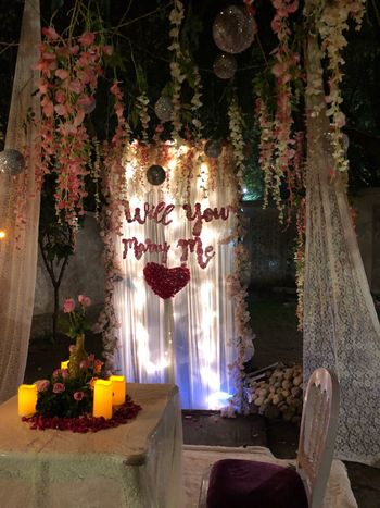 Cute proposal idea with curtains and flowers