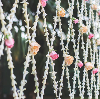 Pretty floral decor with pink and orange flowers for wedding